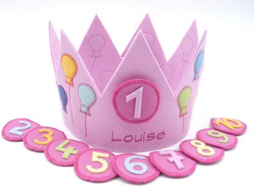 Geburtstagskrone mit Luftballons in rosa